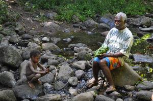Chief of Ikiti near high waterfall
